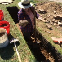 Project archaeologist excavating trench, Patterson Park